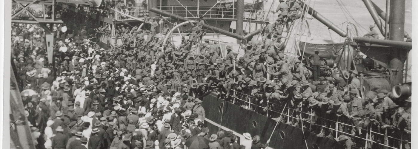 Soldiers farewell their families and loved ones as they board a ship bound for war