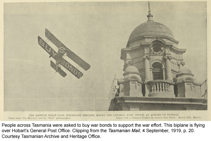 People across Tasmania were asked to buy war bonds to support the war effort. This biplane is flying over Hobart's General Post Office.